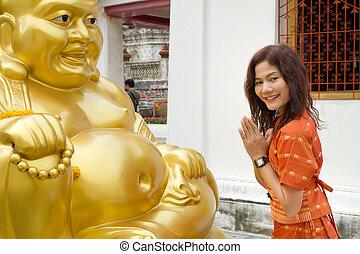 asian woman praying - asian thai woman praying big buddha...