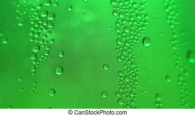Dew drops on green glass