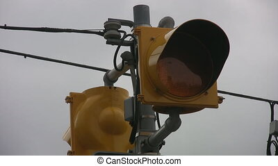Flashing orange light. - A flashing light at a crosswalk...