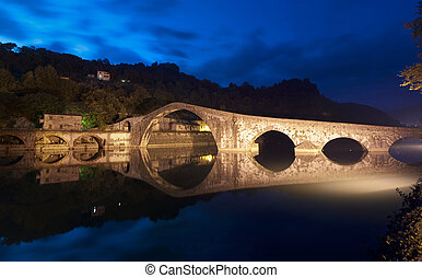 Devils Bridge at Night in Lucca, Italy - Colors and...