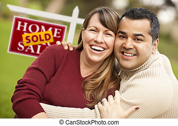 Mixed Race Couple in Front of Sold Real Estate Sign - Happy...