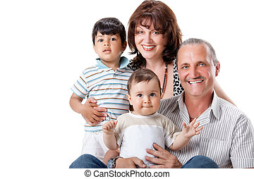 Happy grandparents with two handsome grandsons , isolated on...