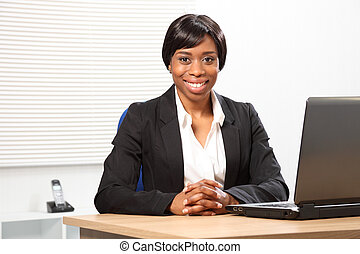 Beautiful happy black business woman in office - Happy young...