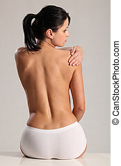 Shoulder back pain for semi naked young woman - Beautiful...