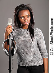 Beautiful black girl singer in studio relaxing - Beautiful...
