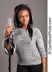 Beautiful black girl singer in studio relaxing - Beautiful...