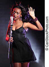 Beautiful black singer on stage with microphone - Beautiful...