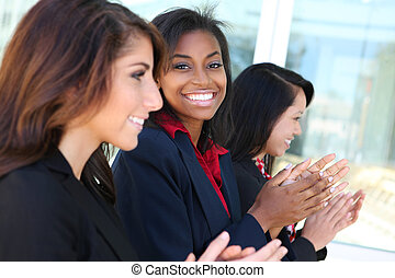 Diverse Business Team Clapping - A diverse business woman...