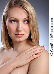 Headshot of beautiful blonde woman looking sad
