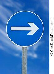 Arrow sign against deep blue sky