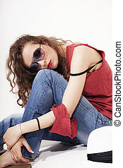 woman in red T-shirt and blue jeans