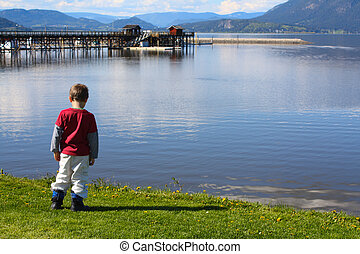 Lake - Cute boy standing at the edge of a lake