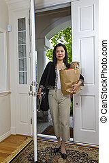 Women coming home - Asian women comes home after shopping...
