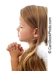 Adorable little girl praying peacefully - isolated, closeup