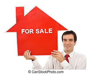 Salesman with house for sale sign - Salesman smiling holding...