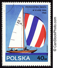 Yacht Finn on post stamp - POLAND - CIRCA 1963: stamp...