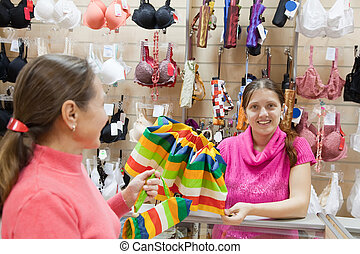 Saleswoman at  counter in  shop