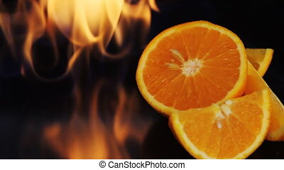 Oranges in fire flame
