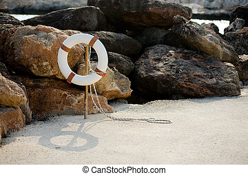 Lifebuoy hangs on a stick on the beach - White lifebuoy...