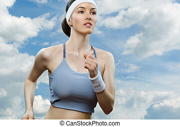 girl in sport on the sky background
