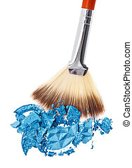 Makeup wide brush with blue crushed eye shadow, isolated on...