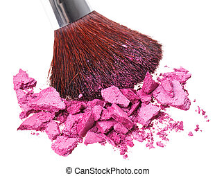 Makeup brush with purple crushed eye shadow, isolated on...