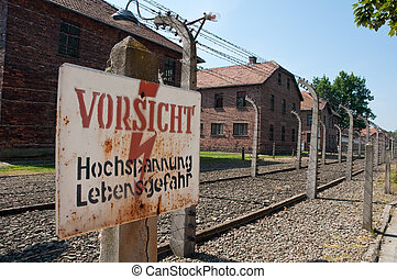 concentration camp - electric wired fence warning sign in...
