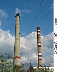 Two power plant chimneys against blue sky - Two power plant...