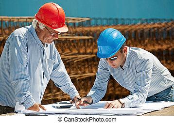 Young engineer and senior foreman