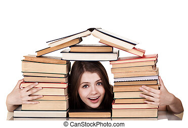 Teen girl with lot of books around, isolated on white