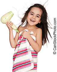 Little girl with hairdryer - Little girl dries hair after...