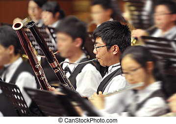 bassoon boy performs on concert