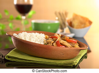 Peruvian food called Lomo Saltado made of meat, bell pepper...