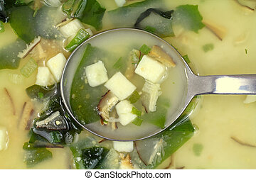 White miso soup with spoon - A very close view of miso soup...