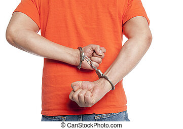criminal in handcuffs - man struggling with handcuffs on his...