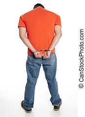 criminal in handcuffs - vertical of man in handcuffs on his...
