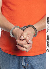 criminal in handcuffs - Close-up vertical of man in...