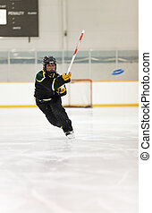 Ringette Player - A young Ringette player throws the ring.