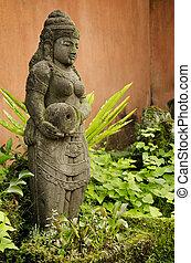 statue in bali indonesia garden