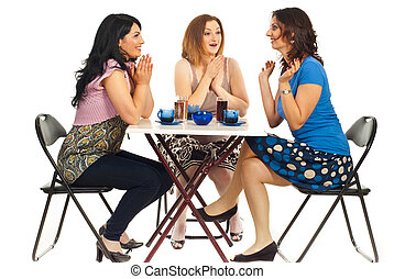 Two women congratulate their friend - Three women sitting on...