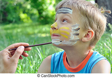 face mask - outdoor portrait of a child with his face being...