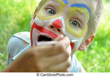 child face mask party painting - outdoor portrait of a child...