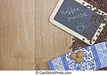Coffee break - Coffee beans on wood with a chalkboard and...