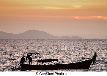boat sunset scene - fisherman and boat silhouette at sunset,...