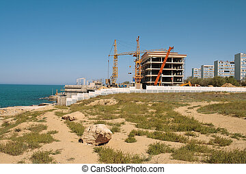 Construction on the beach. - Construction on the shores of...