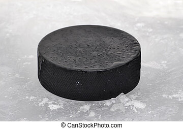 Puck - hockey puck on ice