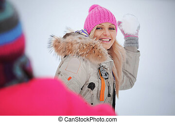 play snowballs - winter woman play snowballs on snow...