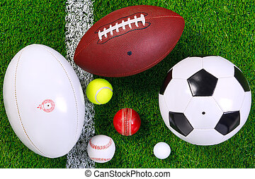 Sports balls on grass from above.