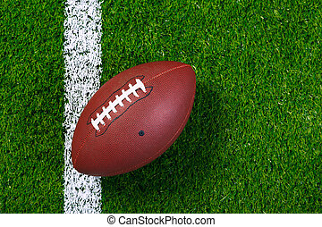 American football on grass from above - Photo of an American...