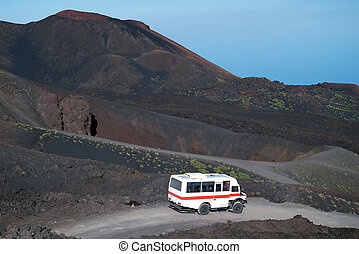 Road to Etna volcano with minibus, Sicily, Italy